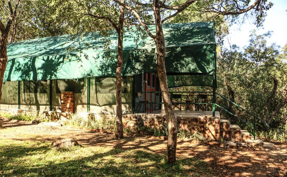 tented camp , luxury safari
